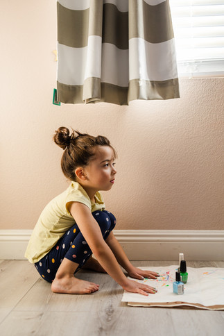 Young girl painting her nails