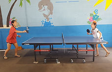 Girls play ping pong.jpg
