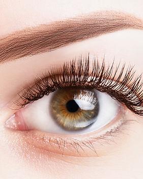 female-eye-with-long-eyelashes-classic-eyelash-extensions-light-brown-eyebrow-close-up.jpg