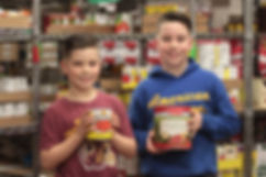Children holdin canned goods.