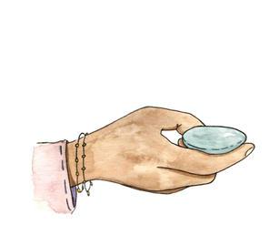 Hand holding rock