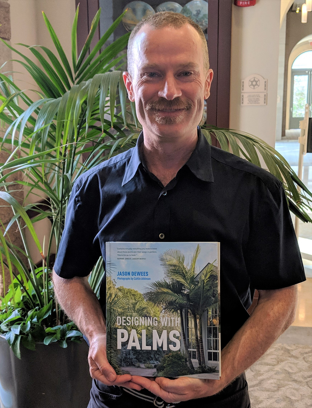 Jason DeWees shared pictures and stories about palms at the July 9 meeting.