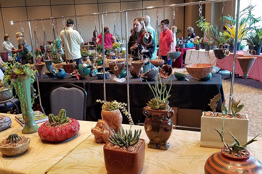 Members shop at the Succulent Plant and Pottery Faire at October's meeting.