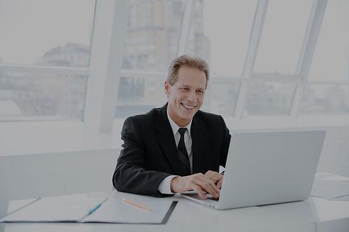 graphicstock-elderly-business-man-sittin