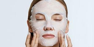 facial-mask-woman-using-sheet-mask-on-fa