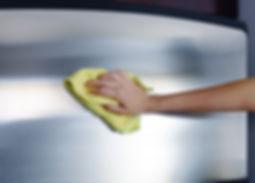 Woman's hand with microfiber cloth polis