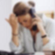 depressed woman on phone