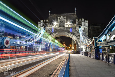 busy bus trails on London Tower Bridge
