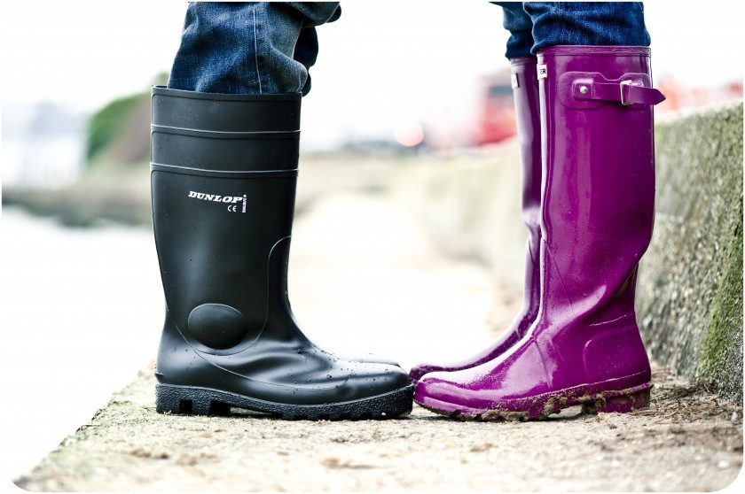 Bride and groom face each other wearing funky wellies - Dorset wedding photographer