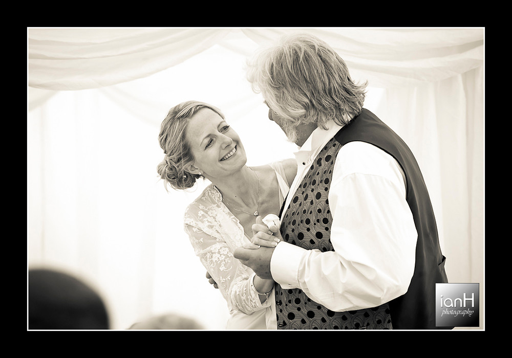 father-and-daughter-dancing-at-her-bournemouth-beach-wedding-anniversary
