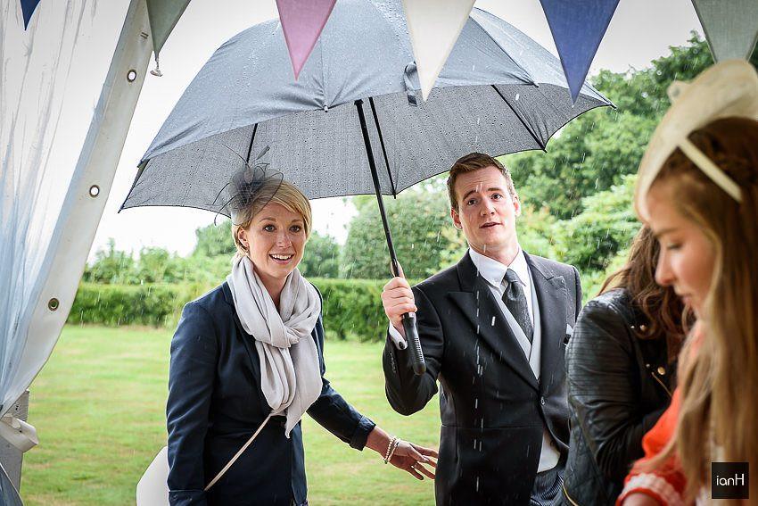 smiles at wet weather wedding