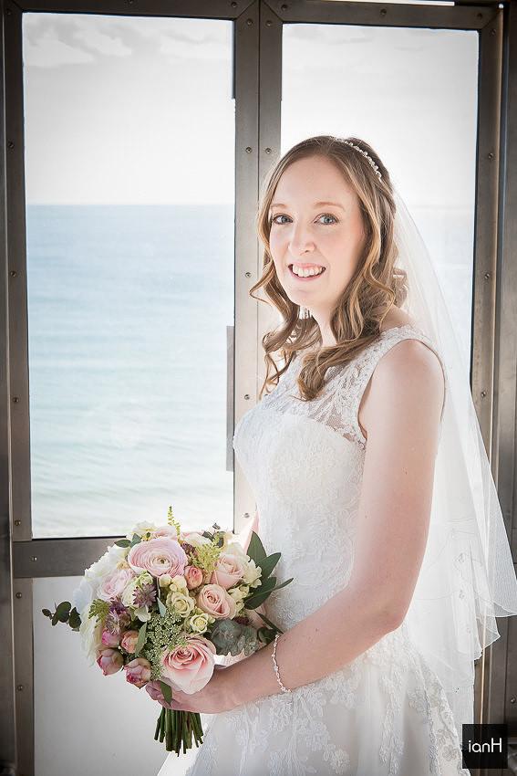 Bournemouth beach wedding Bride in cliff-lift