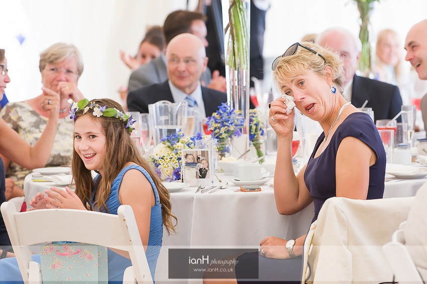 Guests crying with laughter during wedding speeches