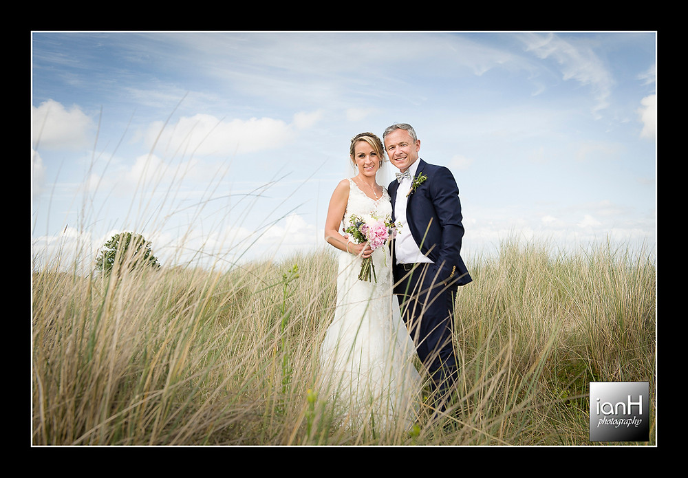 Studland church wedding with Bride and Groom in the sand dunes
