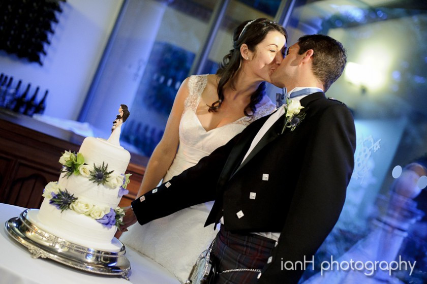 Bride and Groom cut the cake at the Italian Villa Bournemouth