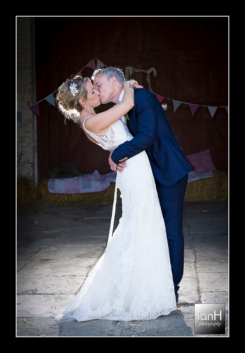 Studland church wedding with the dip and a kiss backlit by flash