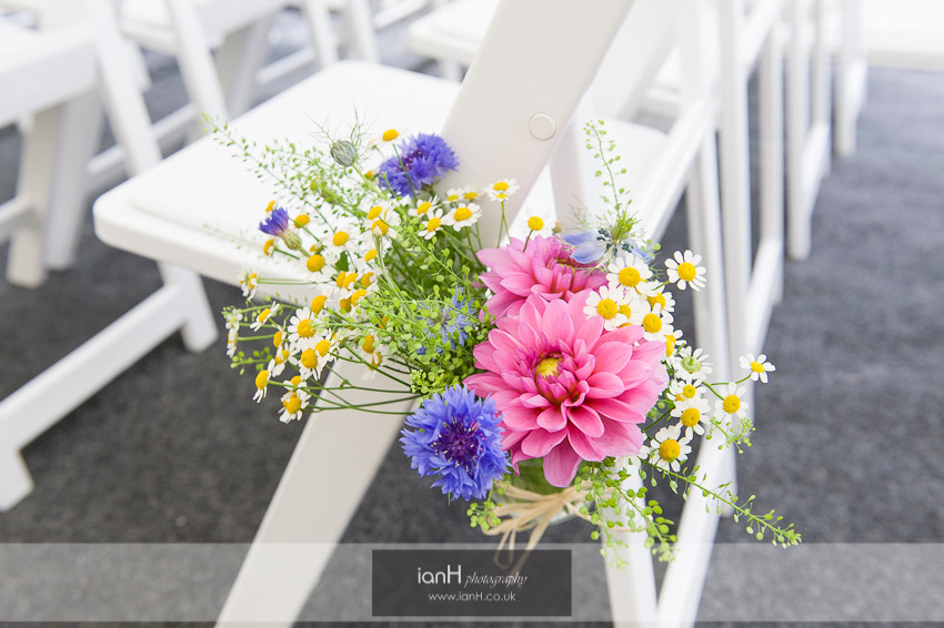 Pew end flowers at Hampshire wedding