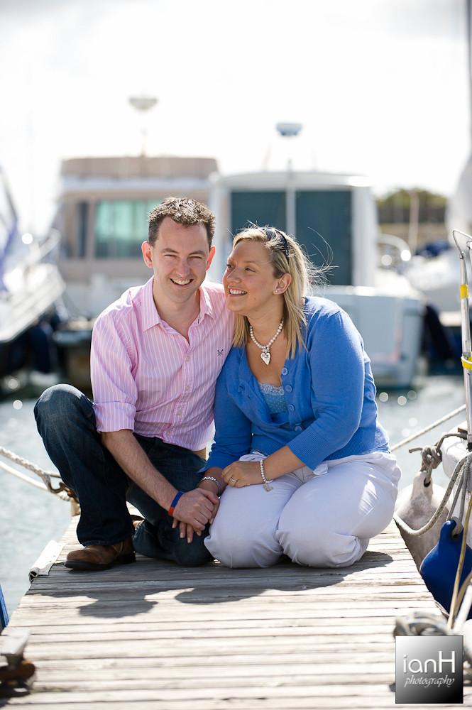 Happy engaged couple at Lymington marina