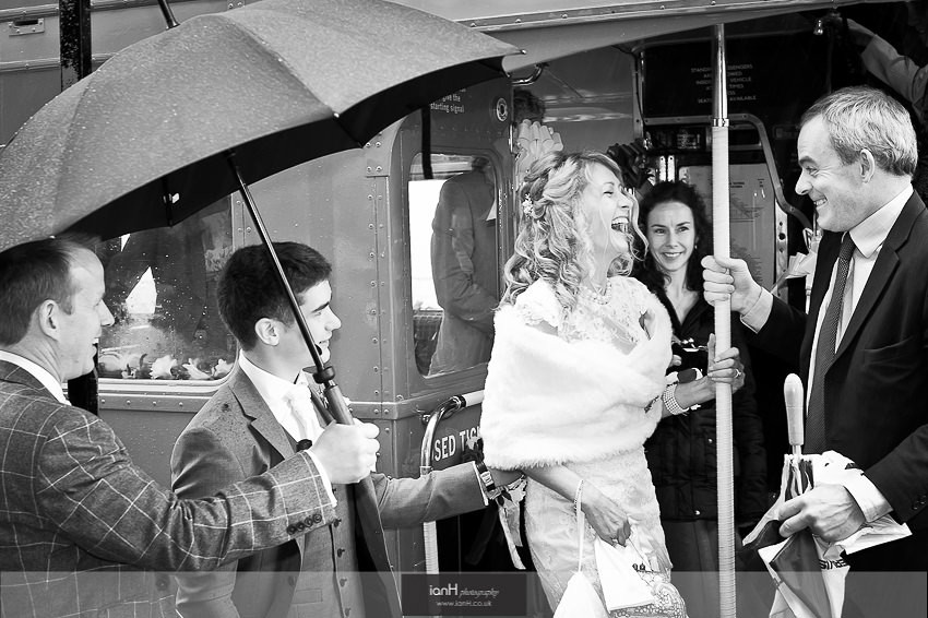 Bride laughing on a double decker bus Bournemouth