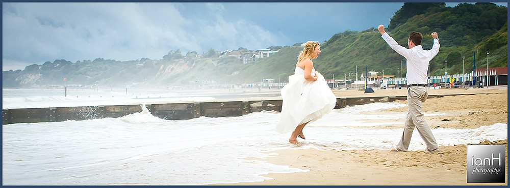 Beach Weddings Bournemouth anniversary - Jen and Dan getting wet