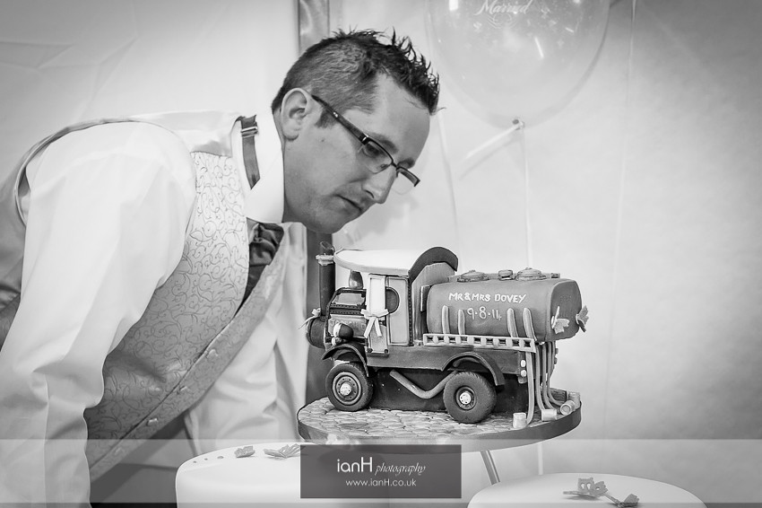Groom inspecting his steam engine wedding cake