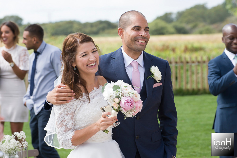 Smiling Bride and Groom at Sopley Mill wedding