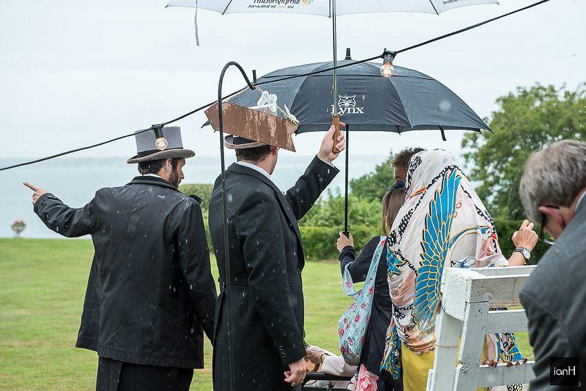 rain pouring down at Studland wedding