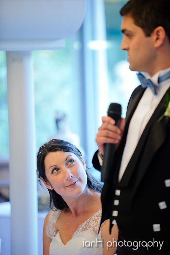 Bride looking lovingly at Groom during speeches