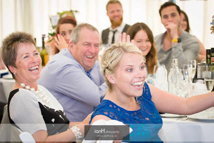Laughter during speeches at a Hampshire country marquee wedding