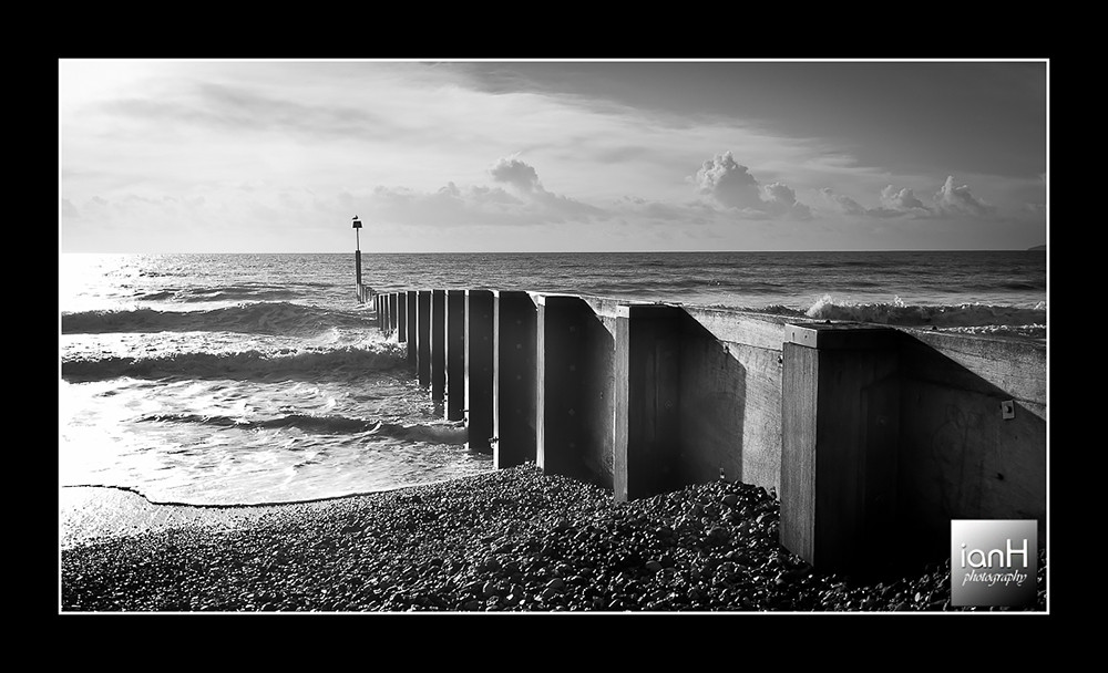 Moody-black-white-image-of-sunlit-groyne-on-Bournemouth-beach