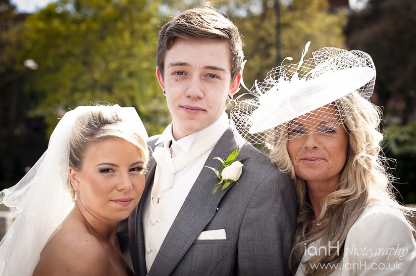 Groom_flanked_by_his_Bride_and_her_Mother_at _a_wedding_ceremony_in_Bournemouth_Town_Hall