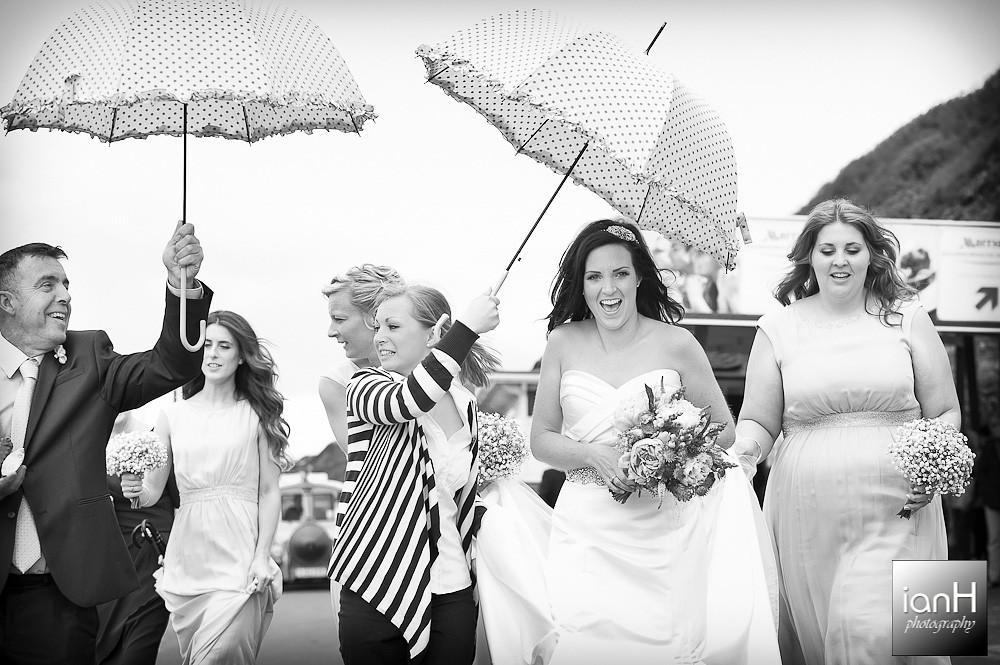 bride-with-bridesmaids-make-their-way-to-bournemouth-beach-weddings