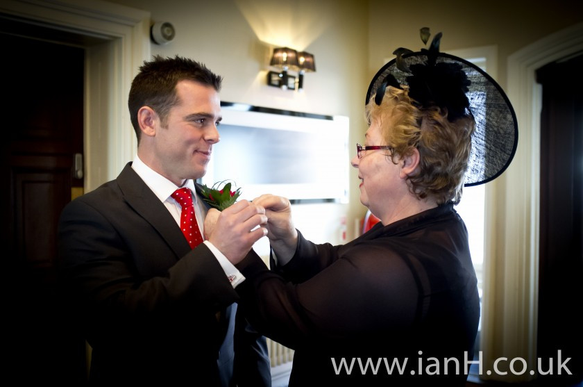 Bournemouth_wedding_photography_-_Mother_helps_Groom_with_his_buttonhole