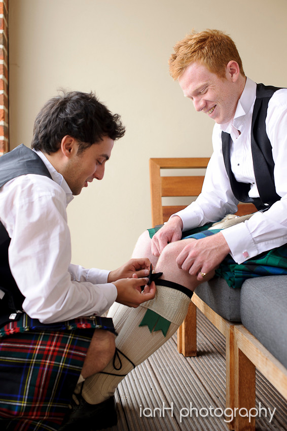 Ushers in kilts preparing for the wedding