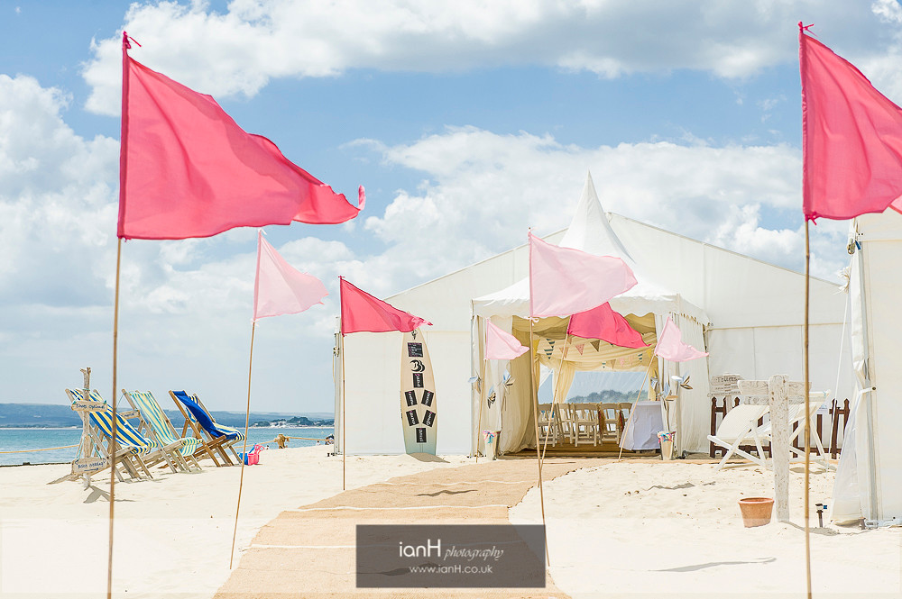 Pink flags at beach wedding