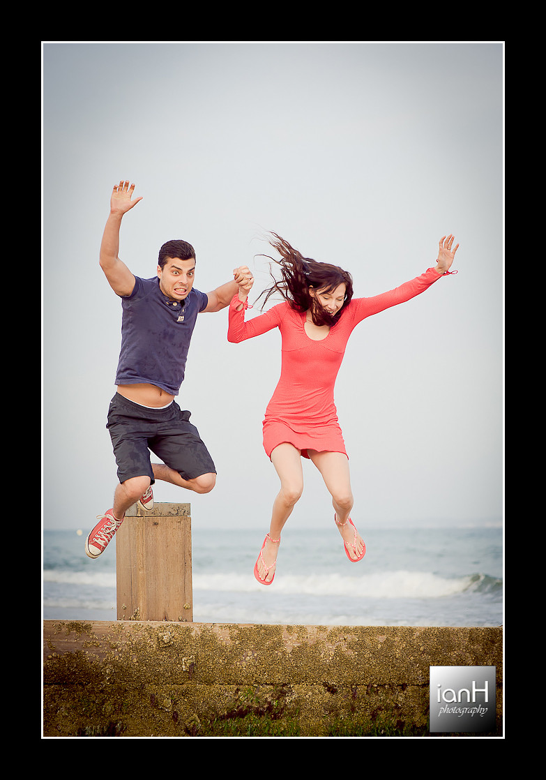 bournemouth-wedding-photographer-image-of-the-week-23-couple-leaping-onto-Bournemouth-beach