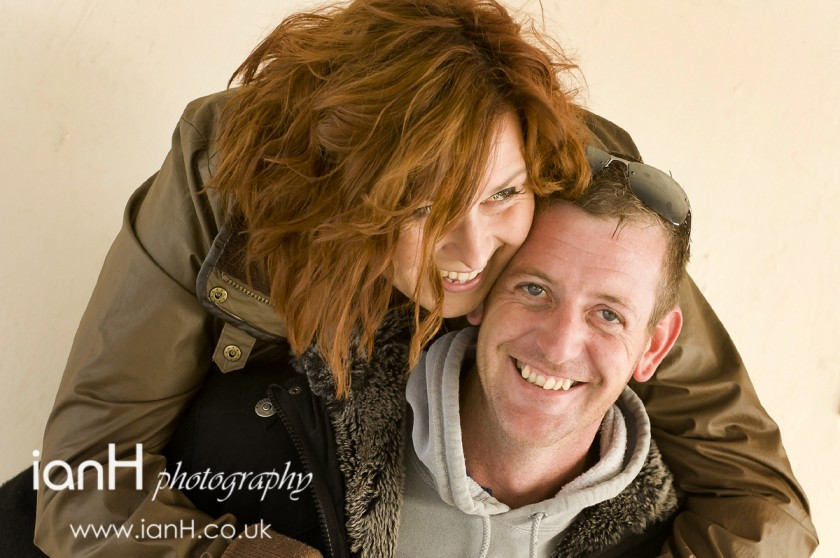 Happy engaged couple laughing - Dorset wedding photographer