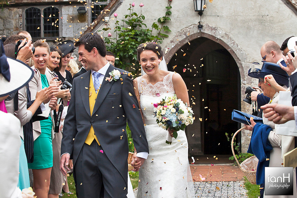 new-forest-wedding-bride-and-groom-leave-church-showered-in-confetti