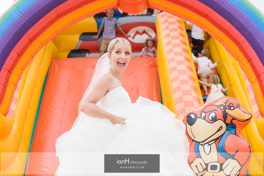 Bride in bouncy castle - Bournemouth beach wedding