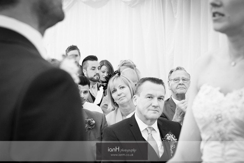Proud parents watching their daughter at her wedding