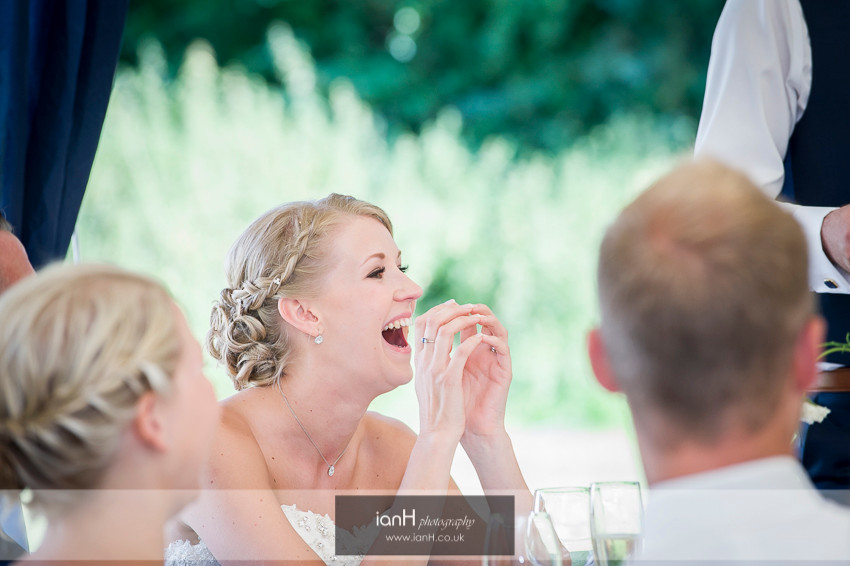 Bride's laughter during wedding speeches
