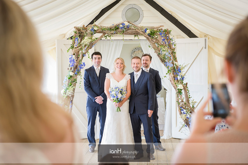Guests photograph Bride and Groom on Bournemouth beach