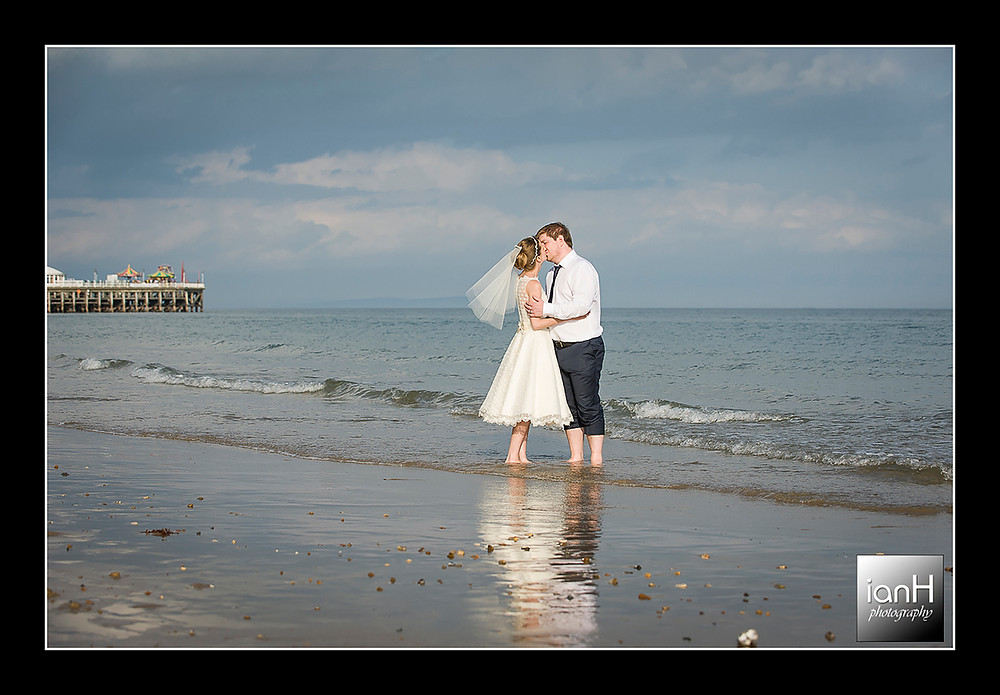 Beach Weddings Bournemouth - Sarah & Andy kissing in the sea as the waves lap onto the beach