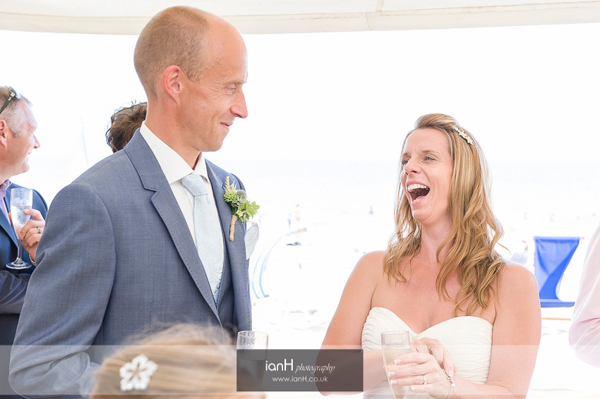 Laughter from the Bride during the speeches at a Bournemouth beach wedding