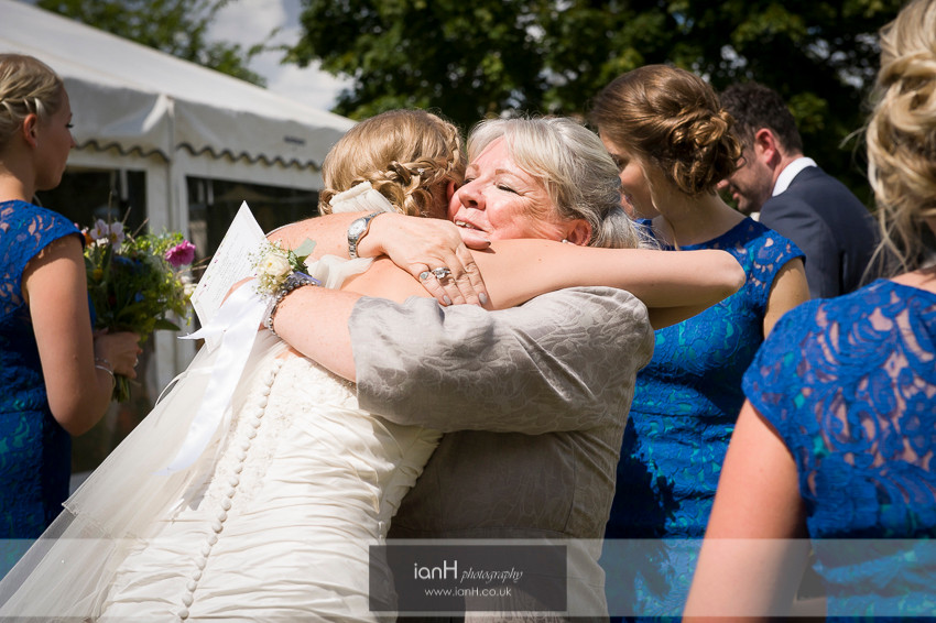 The Bride being hugged by the Groom's Mother