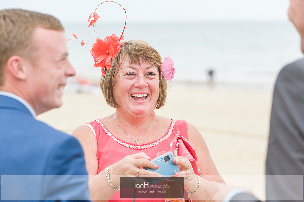 Laughter at beach wedding