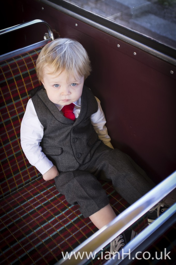 Cute_page_boy_aboard_a_Routemaster_bus_by_Bournemouth_wedding_photographer