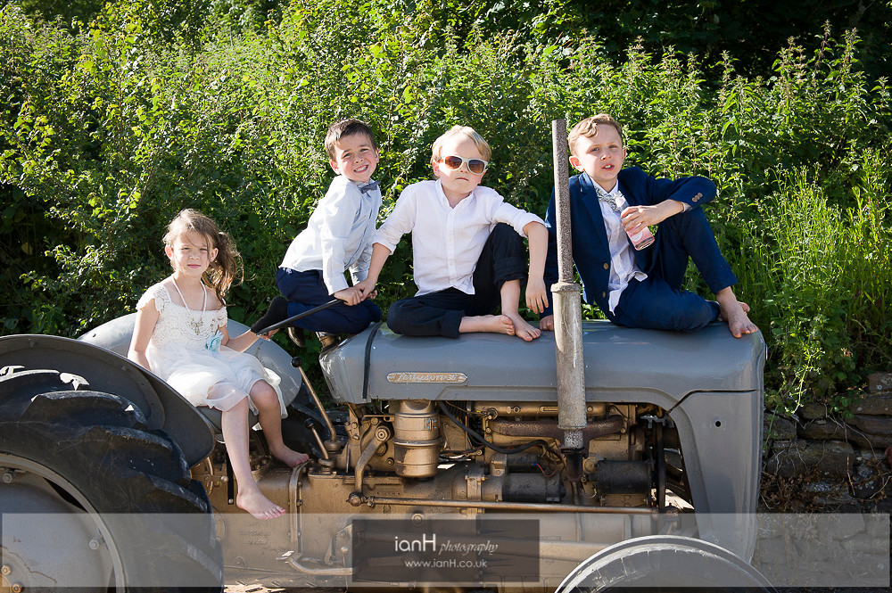 Children on vintage tractor at Studland wedding