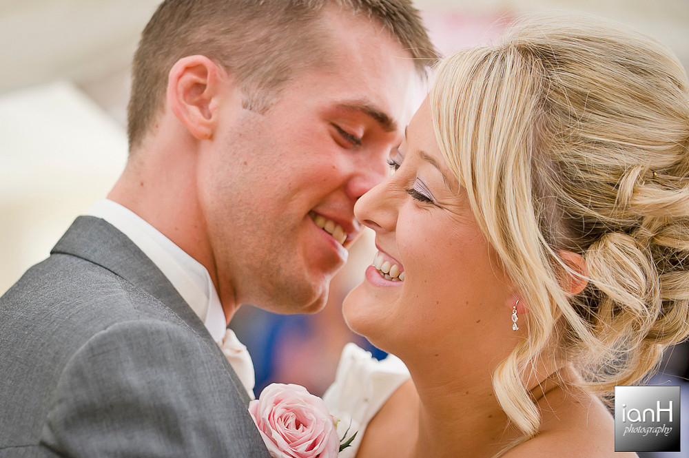 smiling-bride-and-groom-at-their-bournemouth-beach-wedding