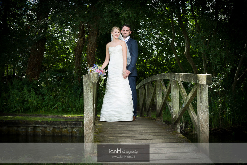 Bride and Groom on a bridge over a Hampshire river